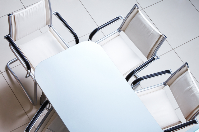 Above view of plastic table with several chairs near by